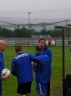 Phil Parkinson talks to his coaching staff