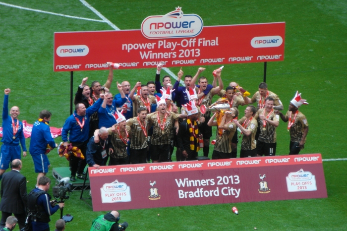 Nick Allamby (far left) joins in the promotion celebrations